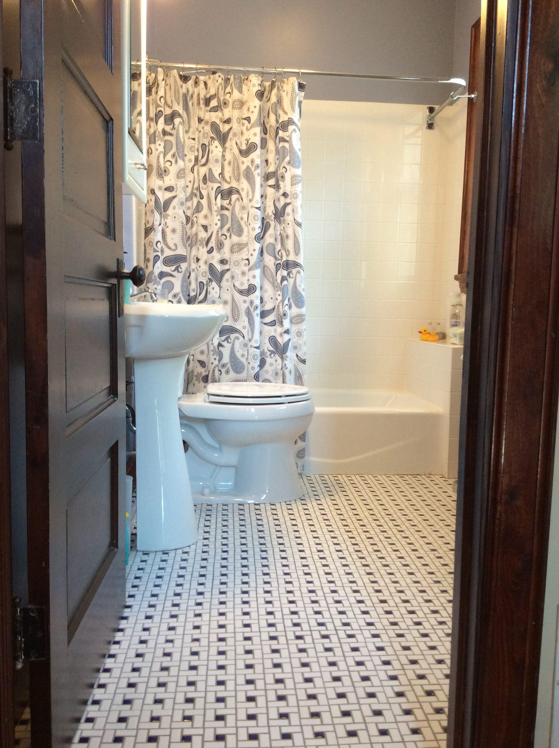 Fresh, clean tiled bathroom with rain shower head.
